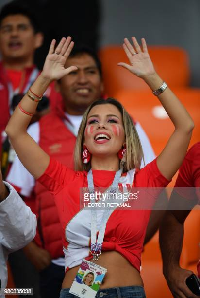 A Peruvian fan cheers ahead of the Russia 2018 World Cup Group C football match between France and Peru at the Ekaterinburg Arena in Ekaterinburg on...