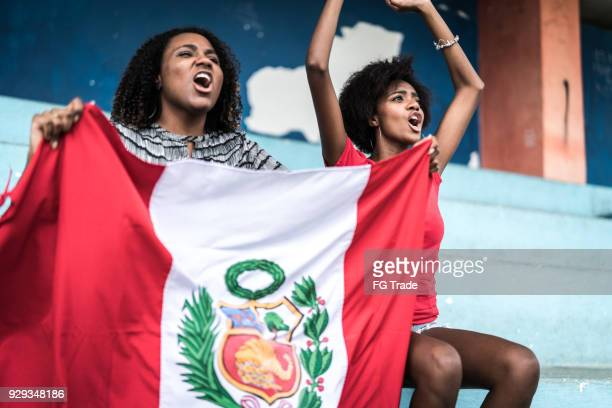 peruvian fans watching a soccer game - peru stock pictures, royalty-free photos & images