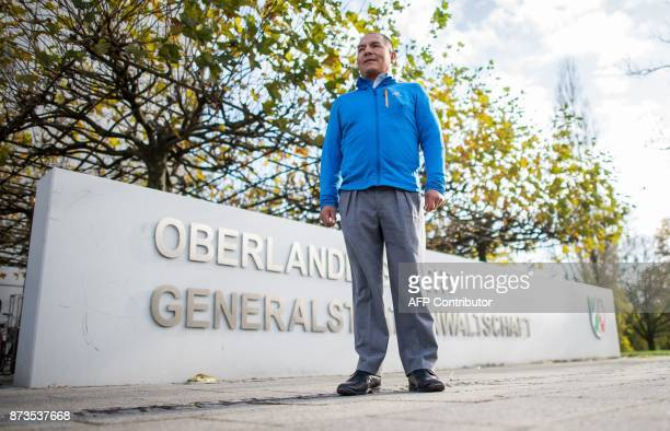 Peruvian farmer Saul Luciano Lliuya stands outside the higher regional court of Hamm western Germany where the hearing of an appeal began on November...