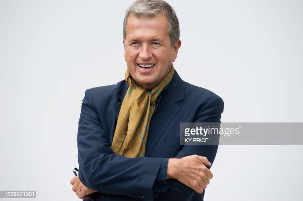 Peruvian fashion photographer Mario Testino arrives for the Burberry's 2012 Spring Summer show on September 19, 2011 during the London Fashion week....