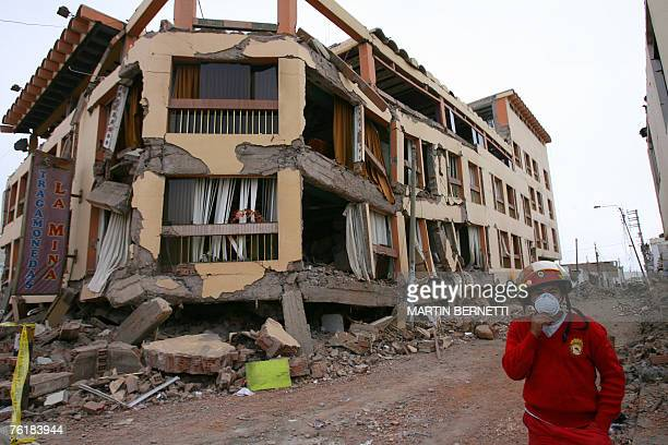A Peruvian firefighter walk by a heavy damaged building during August 15th 2007 earthquake in Pisco 20 August 2007 Rescue teams in Peru's shattered...