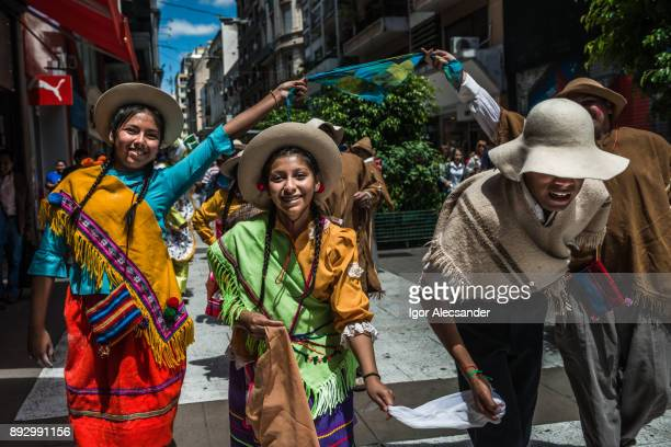 peruvian folklore group in street florida, buenos aires, argentina - argentina traditional clothing stock photos and pictures