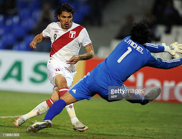 Peruvian footballer Paolo Guerrero scores against Mexico during a 2011 Copa America Group C first round football match held at the Malvinas...