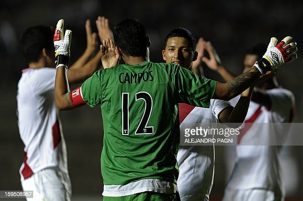 Peruvian footballers celebrate after defeating Venezuela by 1-0 in their South American U-20 Championship Group B qualifier football match, at...
