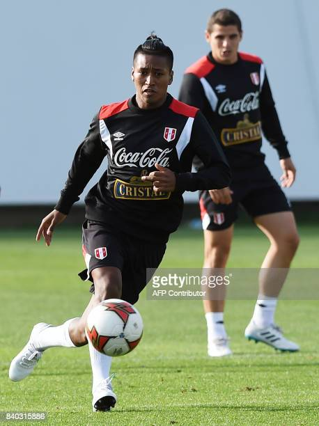 Peruvian footballers Pedro Aquino and Aldo Corzo take part in a training session in Lima on August 28 ahead of Peru's 2018 FIFA World Cup Russia...