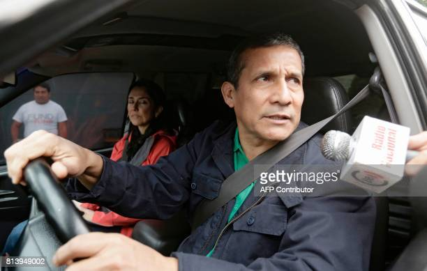 Peruvian former president Ollanta Humala speaks to the press as he leaves his home next to his wife Nadine Heredia in Lima on July 13 2017...