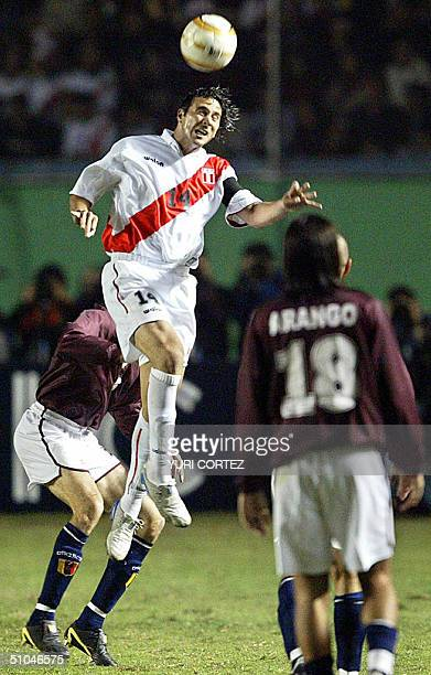 Peruvian forward Claudio Pizarro heads the ball during a Copa America match against Venezuela 09 July 2004 in Lima Peru Pizarro who plays in the...