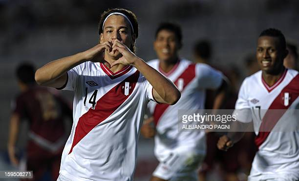 Peruvian forward Cristian Benavente celebrates after scoring a goal against Venezuela during their South American U-20 Championship Group B football...