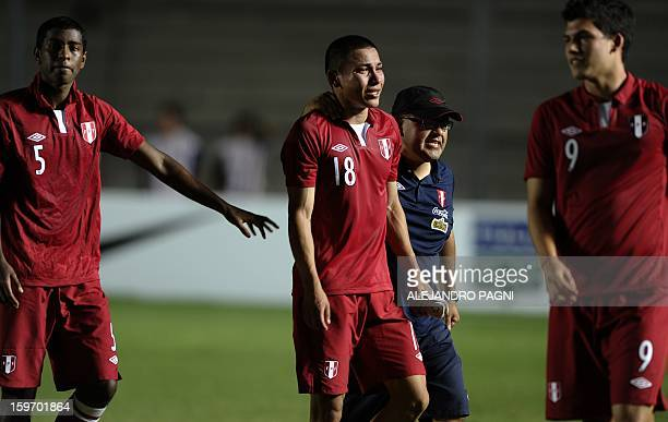 Peruvian forward Jean Deza cries next teammates after his victory against Brazil at the end their South American U-20 Championship Group B football...