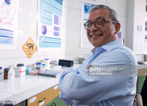 Peruvian genetics specialist Ricardo Fujita poses at his lab in the San Martin de Porres University in Lima on May 11 2018 Upon the many programs he...