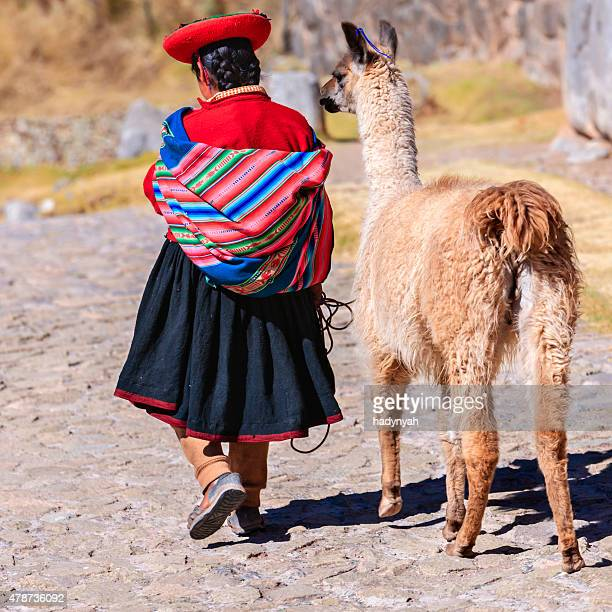 peruvian girl wearing national clothing posing with llama near cuzco - quechua people stock pictures, royalty-free photos & images