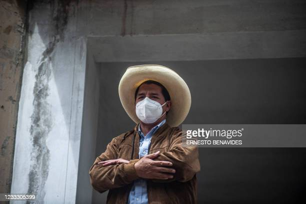Peruvian left-wing presidential candidate for Peru Libre party, Pedro Castillo, waves to supporters after casting his vote in Tacabamba, Cajamarca...