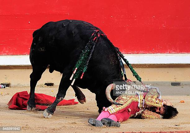 Peruvian matador Andres Roca Rey is gored by a Fuente Ymbro's bull during the first corrida of the San Fermin Festival in Pamplona on July 7 2016 The...