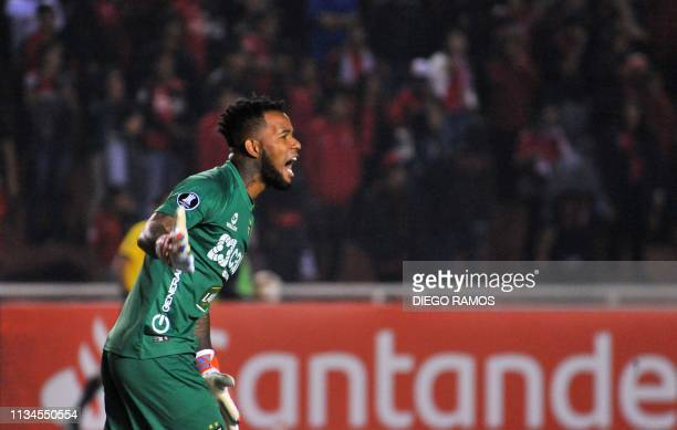 Peruvian Melgar goalie Carlos Caceda yells instructions during a Copa Libertadores football match against Colombian Junior in Arequipa Peru on April...