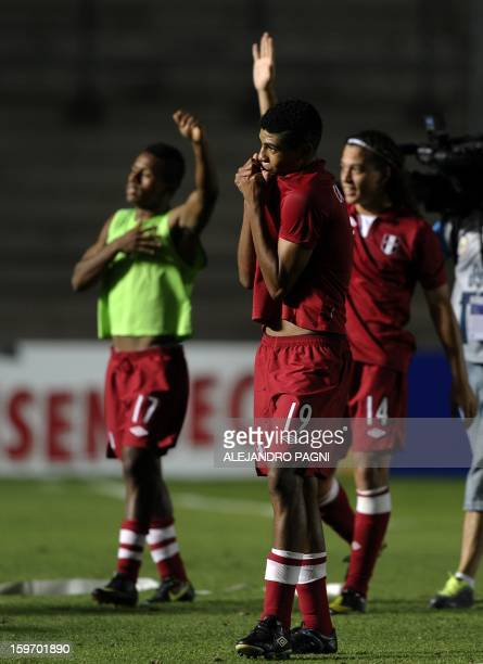 Peruvian midfielder Wilder Cartagena , forward Yordi Reina and forward Cristian Benavente celebrate after the victory against Brazil at the end their...
