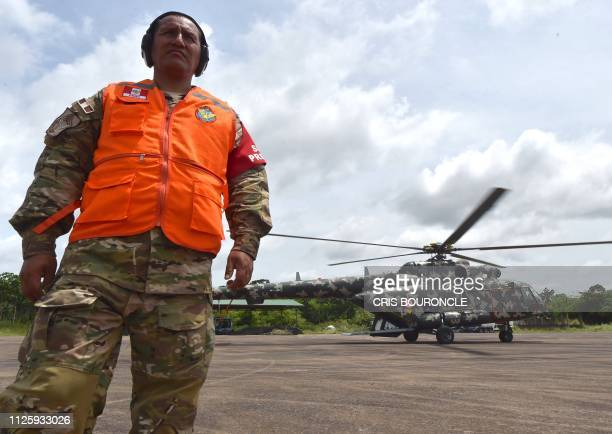 Peruvian military and police get ready during the 'Mercury' joint operation against illegal mining on February 19 2019 in the Amazon jungle over the...