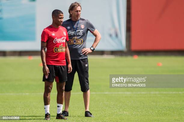 Peruvian national football team head coach Argentinian Ricardo Gareca is pictured next to Peruvian player Andy Polo during a training session in Lima...