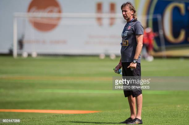 Peruvian national football team head coach Argentinian Ricardo Gareca conducts a training session in Lima on March 15 before the team's departure to...