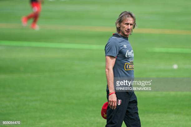 Peruvian national football team head coach Argentinian Ricardo Gareca arrives for a training session in Lima on March 17 before the team's departure...