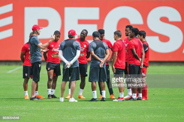 Peruvian national football team head coach Argentinian Ricardo Gareca conducts a training session in Lima on March 17 before the team's departure to...