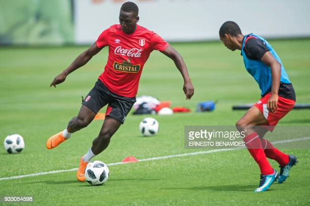 Peruvian national football team player Luis Advincula runs with the ball during a training session in Lima on March 17 before the team's departure to...