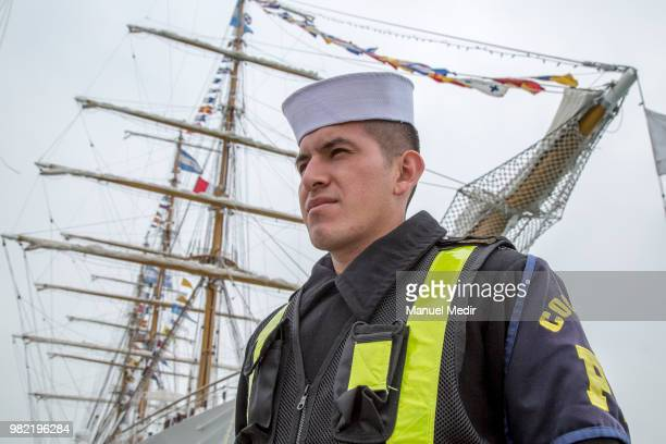 Peruvian officer poses in front of the BAP Union of Peru during the Velas Latinoamerica 2018 Nautical Festival at Callao Naval Base on June 21 2018...