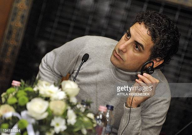 Peruvian operatic tenor Juan Diego Florez listens to a question in the Bertalan Szekely hall of the National State Oper on November 27 during his...