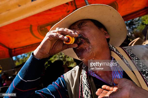 Peruvian peasant drinks liquor during the Yawar Fiesta, a ritual fight between the condor and the bull, held in the mountains of Apurímac,...