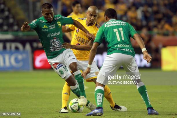 Peruvian Pedro Aquino and Colombian Yairo Moreno of Leon vie for the ball with Luis Rodriguez of Tigres during the Mexican Clausura football...