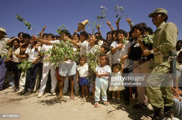 Peruvian People acclaim army general Alberto Arcienega in his fight against guerillas and drug trafficking in December 1989 in Peru.