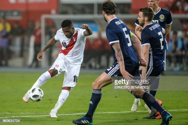 Peruvian player Jefferson Farfan vies for the ball with Charlie Mulgrew from Scotland during a friendly match at the National Stadium in Lima on May...