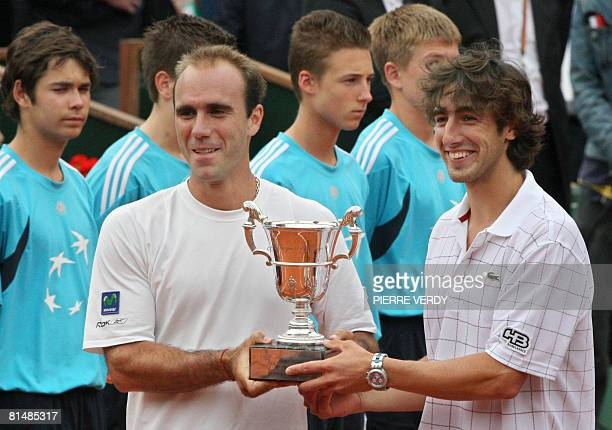 Peruvian player Luis Horna and Uruguayan player Pablo Cuevas hold the trophy after beating Serbian player Nenad Zimonjic and Canadian player Daniel...