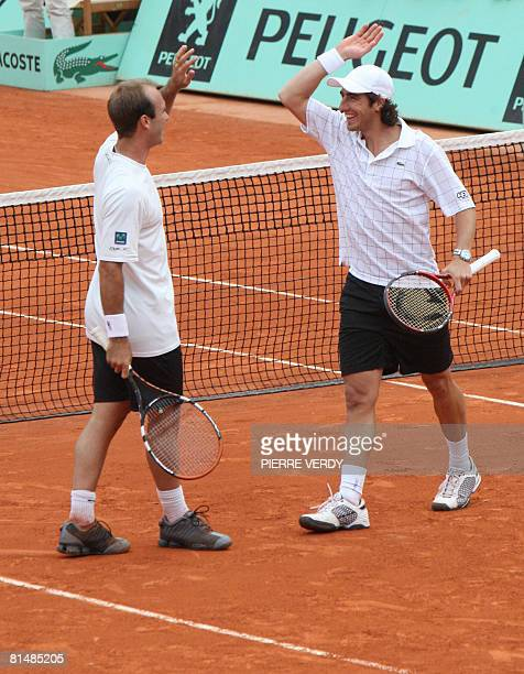 Peruvian player Luis Horna and Uruguayan player Pablo Cuevas react after beating Serbian player Nenad Zimonjic and Canadian player Daniel Nestor...