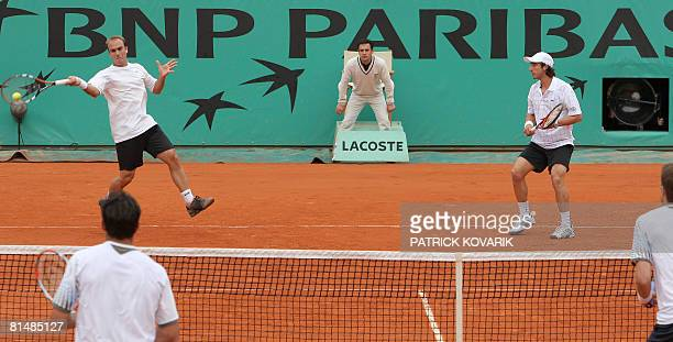 Peruvian player Luis Horna and Uruguayan player Pablo Cuevas return a shot to Serbian player Nenad Zimonjic and Canadian player Daniel Nestor during...