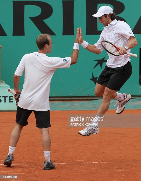 Peruvian player Luis Horna jubilates with Uruguayan player Pablo Cuevas after beating Serbian player Nenad Zimonjic and Canadian player Daniel Nestor...