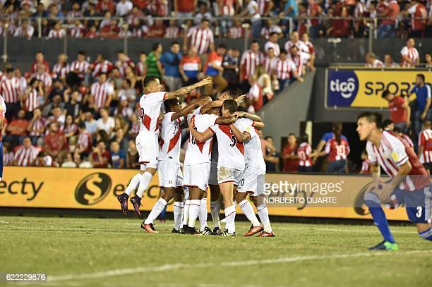 Peruvian players celebrate a goal against Paraguay during their FIFA 2018 World Cup qualifier football match in Asuncion on November 10 2016 / AFP /...
