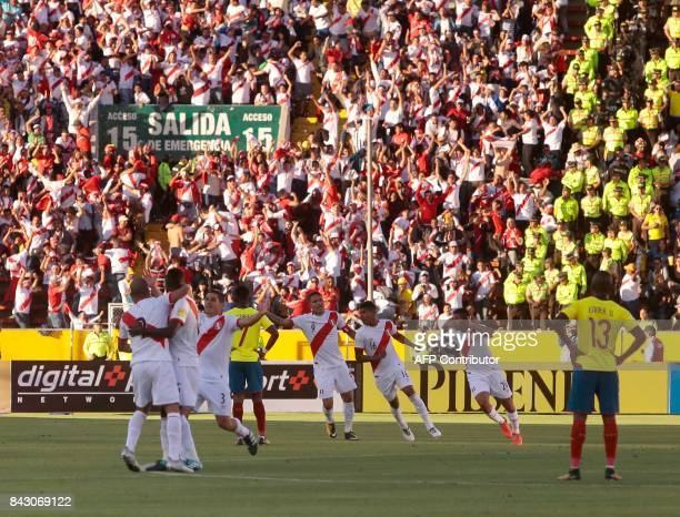 Peruvian players celebrate after scoring against Ecuador during their 2018 World Cup qualifier football match in Quito on September 5 2017 / AFP...
