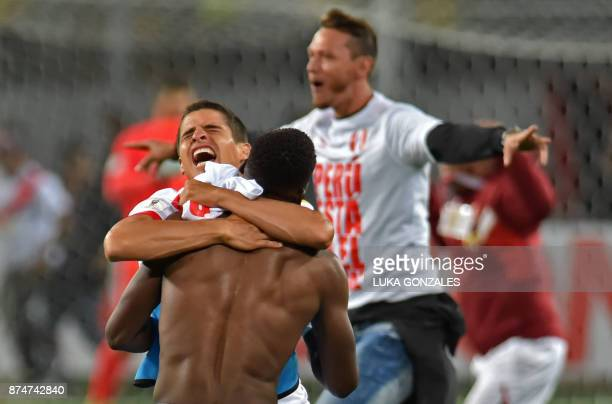Peruvian players Miguel Trauco and Luis Advincula celebrate after defeating New Zealand by 20 and qualifying for the 2018 football World Cup in Lima...
