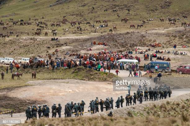 Peruvian police monitor an indigenous protest against the proposed Conga gold mine in the Andes highlands of Cajamarca Peru Photo taken March 22...