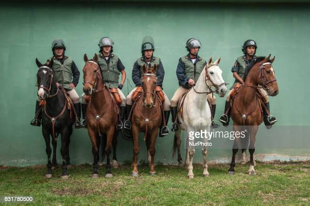 Peruvian police officers mounted on horses watch over protesters at rally against the proposed Conga Gold Mine in Cajamarca Peru on 9 March...