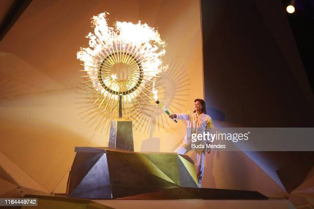 Peruvian Politician and retired volleyball player Cecilia Roxana Tait Villacorta lights the Pan American flame during the opening ceremony of Lima...