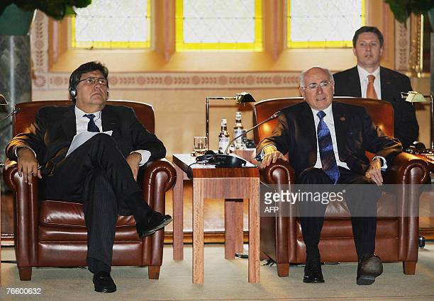 Peruvian President Alan Garcia and Australian Prime Minister John Howard attend the Leaders Retreat II in the ballroom of Government House as part of...