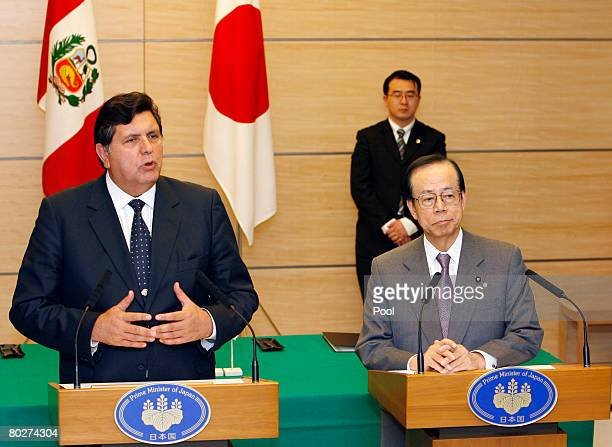 Peruvian President Alan Garcia delivers a speech while Japanese Prime Minister Yasuo Fukuda listens after they signed a cooperation agreement at the...