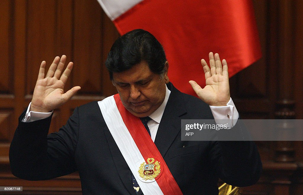 Peruvian President Alan Garcia gestures : News Photo