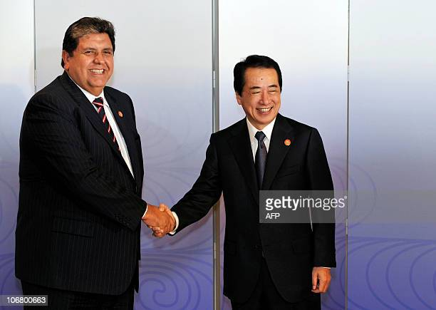 Peruvian President Alan Garcia is greeted by Japanese Prime Minister Naoto Kan before the welcome working lunch at The AsiaPacific Economic...