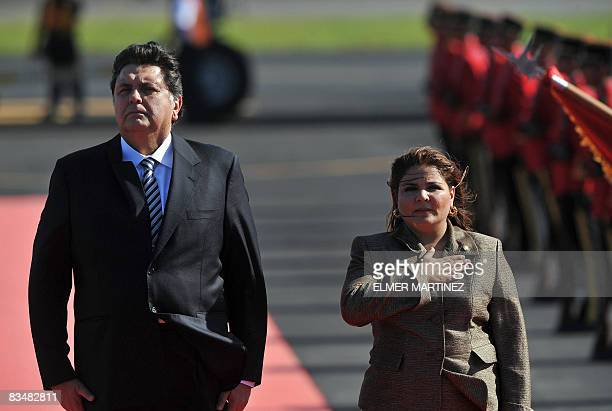 Peruvian President Alan Garcia is welcomed by El Salvador's Foreign Minister Marisol Argueta and saluted by an honor guard upon his arrival to El...