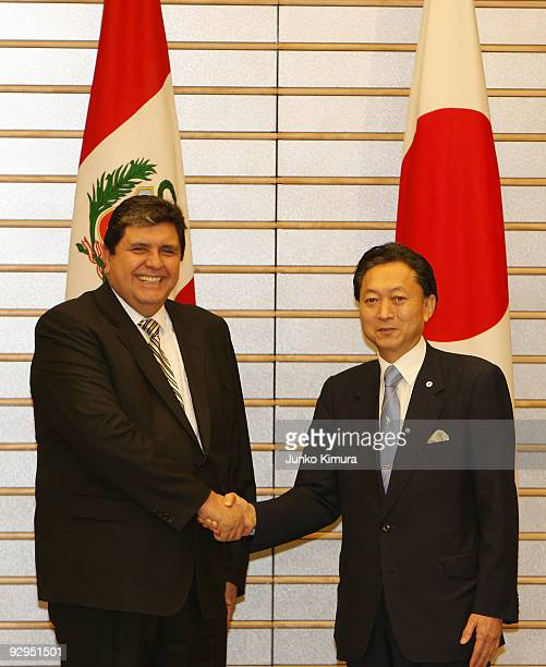 Peruvian President Alan Garcia shakes hands with Japanese Prime Minister Yukio Hatoyama prior to their meeting at Hatoyama's official residence on...