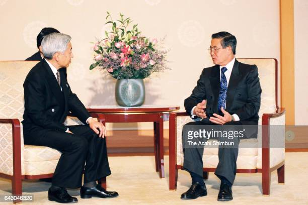 Peruvian President Alberto Fujimori and Emperor Akihito talk during their meeting at the Imperial Palace on July 1, 1998 in Tokyo, Japan.