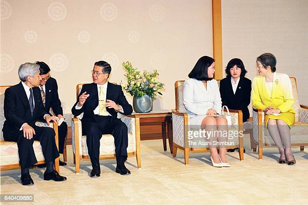 Peruvian President Alberto Fujimori and Emperor Akihito talk while Keiko Fujimori and Empress Michiko talk during their meeting at the Imperial...