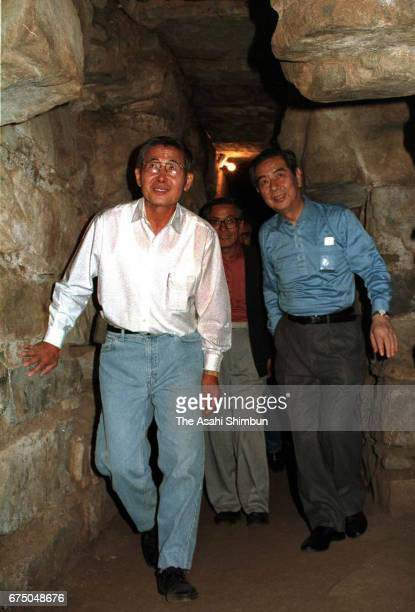 Peruvian President Alberto Fujimori and Japanese Foreign Minister Yukihiko Ikeda are seen visiting the Chavin de Huantar Ruins on April 26 1997 in...